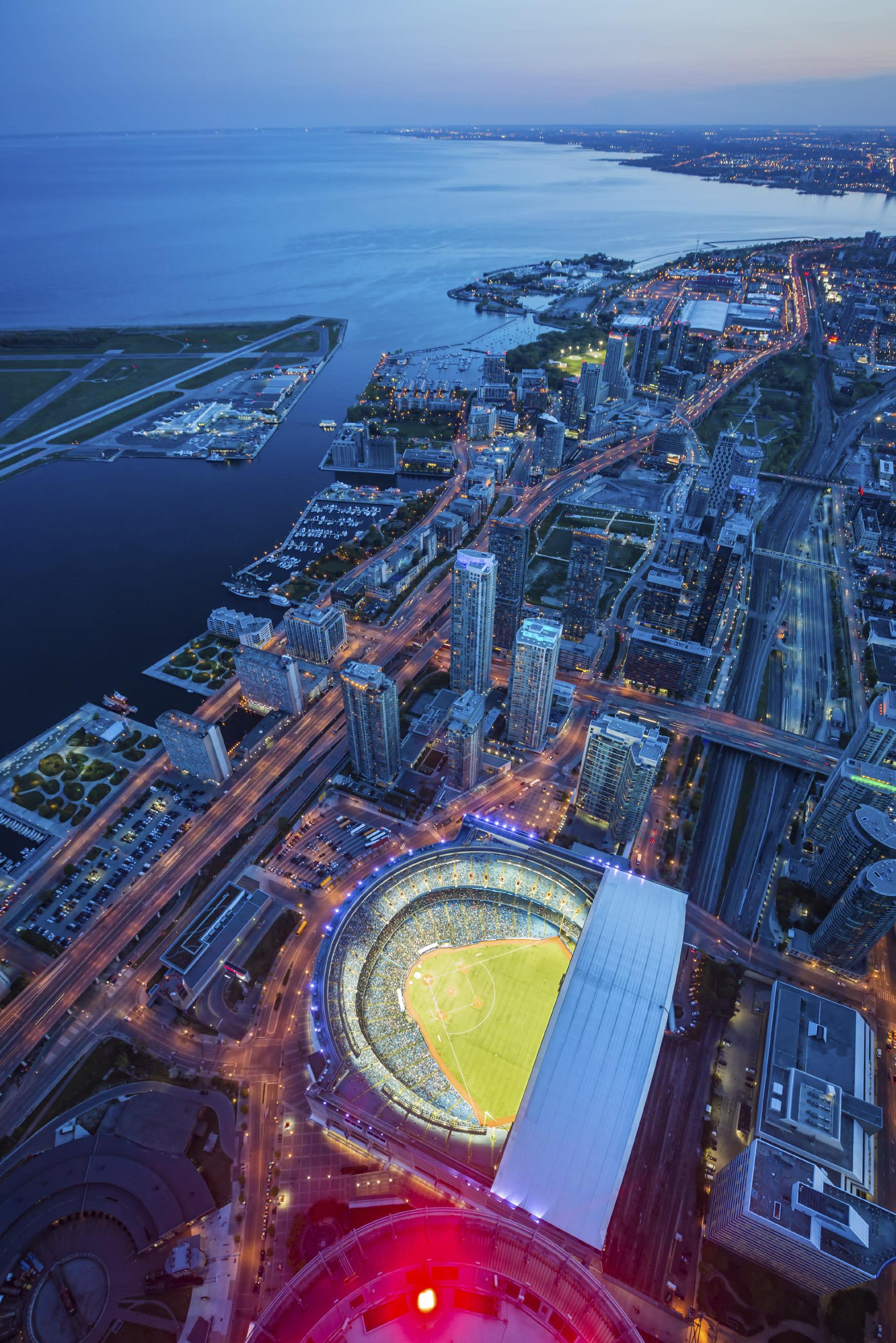 Toronto cityscape with baseball stadium at dusk