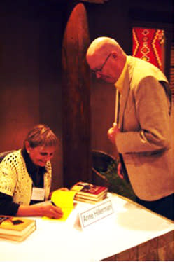 Talking books is serious business at the Tony Hillerman Writers' Conference. Anne Hillerman, Tony's daughter and cofounder of WORDHARVEST, signed books at a recent conference.
