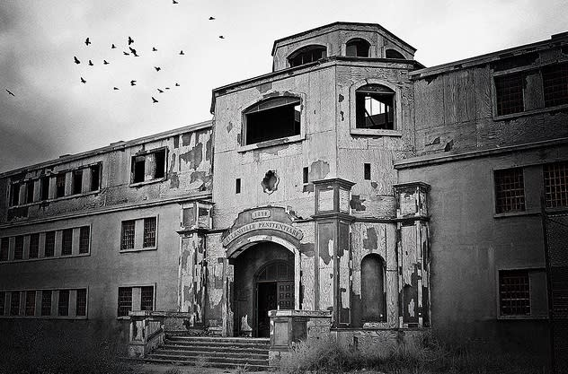 The exterior of Old Main at the New Mexico State Penitentiary evokes a spooky feel.