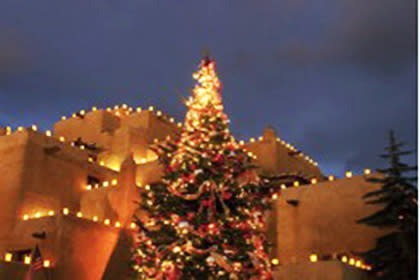Farolitos and a festive tree light up the distinctive Pueblo-style architecture of the Inn and Spa at Loretto.