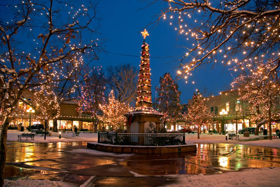 The historic Santa Fe Plaza is picture-perfect at the holidays, and so is gift-hunting at surrounding shops.