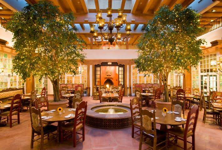 A perennial favorite among Santa Fe visitors, guests at La Plazuela bask in the natural light of its original 1920s-era patio.