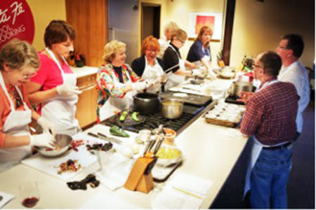 The Santa Fe School of Cooking guides students through the art of preparing green chiles. Green Chile Turkey Enchiladas, anyone?