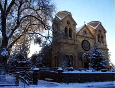 Wrapped up in white, the architectural beauty of Santa Fe's St. Francis Cathedral is a holiday delight.