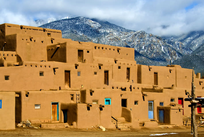 The Taos Pueblo is located 70 miles from Santa Fe in Taos, New Mexico.