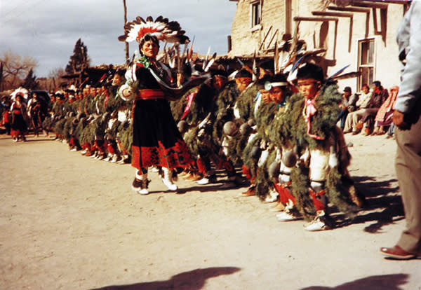 Members of The Tesuque Pueblo perform their Turtle Dance. (Photo courtesy of The New Mexico Art Museum)