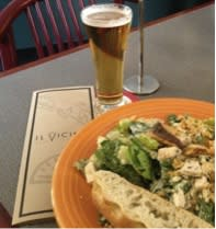 A hearty Caesar salad at Il Vicino lets you save the calories for a cool craft beer!