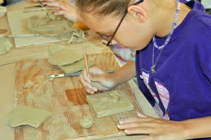 Everyone has a hand in creating a treasure with Family Clay Play.