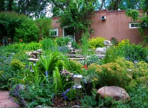 Rocks, plants, adobe … what could be more Santa Fe than being behind adobe walls? (Photo Credit: Santa Fe Garden Club)
