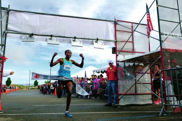 Kenya's Oyugi set a course record in the 2013 Santa Fe Thunder half-marathon. (Photo Credit: Katharine Egli for The Santa Fe New Mexican)