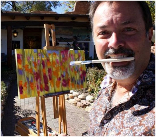 Marshall Noice of Waxlander Gallery gets his teeth into the art experience on Canyon Road! (Photo Credit: visitcanyonroad.com)