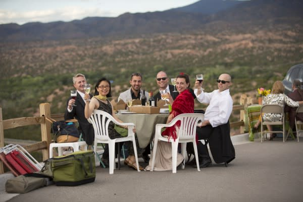 Opera goers raise their glasses and enjoy a full dinner picnic supper. (Photo: Santa Fe Opera)