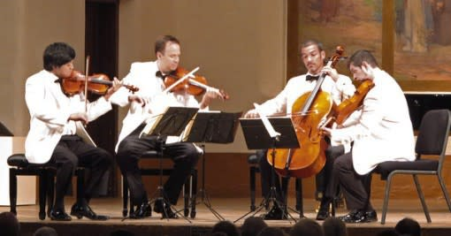 The Miro Quartet strums on stage at the St. Francis auditorium. (Photo: New York Times)