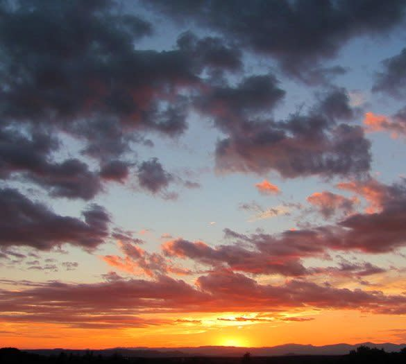 "Don't forget your camera. You will want to capture a ""Santa Fe Sunset""."