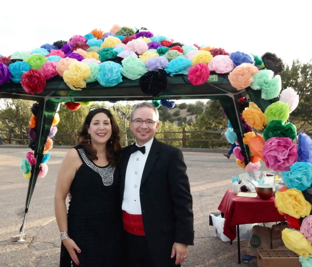 Committed tailgaters like Jennifer and Khristaan Villela dress up the dining canopy to complement the formal wear! (Photo Credit: Lara Nickel)
