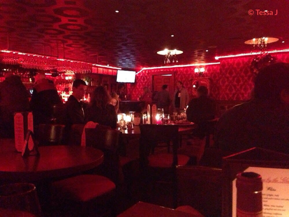 The saloon, with its red, flocked velvet wallpaper recalls the   gambling halls and saloons of yesteryear.