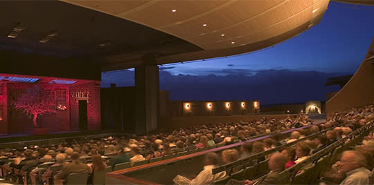 Santa Fe Opera goers enjoy a production in a striking, state-of-the-art, open-air theater .
