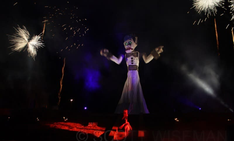 Each year the Firedancer (seen below) taunts and teases Zozobra, much to the crowds delight. (Courtesy of The Burning of Will Schuster's Zozobra.)