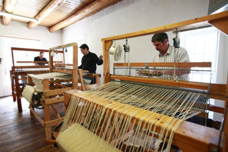 Weaving traditions are passed on through family generations in Chimayó. Courtesy of Ortega Weavers.