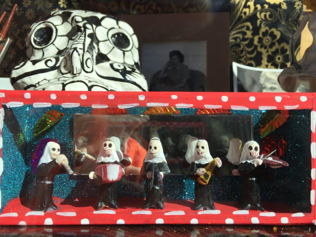 The Mira! window display displays some of its Dia de los Muertos folk art.