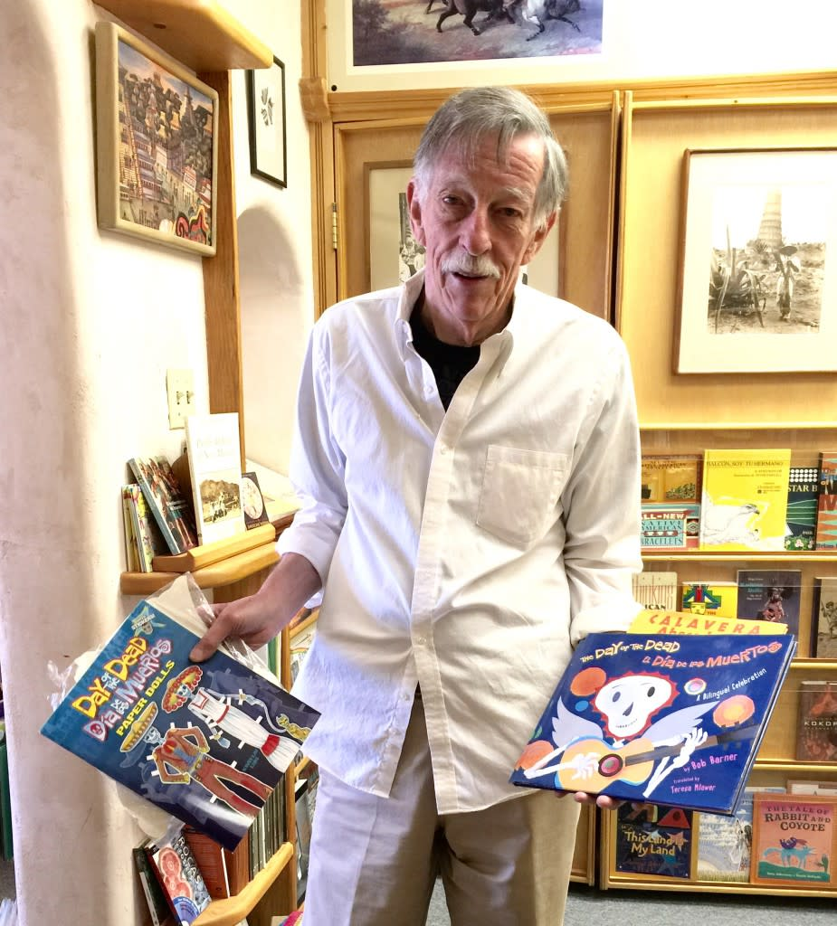 Jim Dunlap of Alla Bookstore with some of his Day of the Dead books for sale.