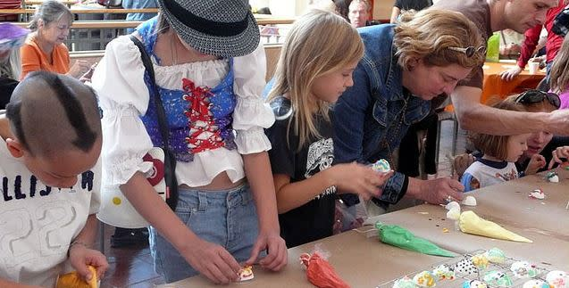 Children participate in sugar skull decorating at the Museum of International Folk Art.
