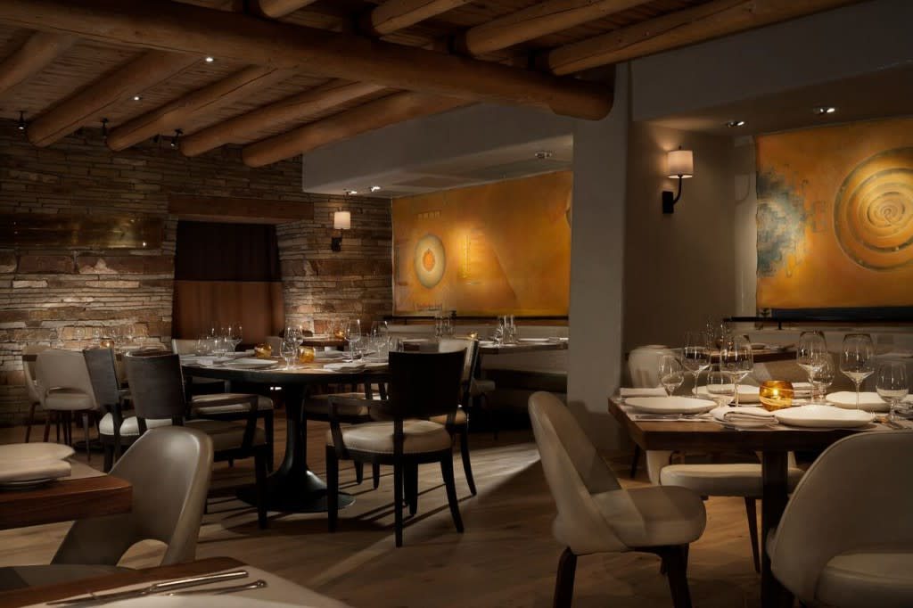 The 40-seat dining room offers guests an intimate dining experience with a sophisticated design featuring leather and linen chairs complementing the natural wood tables. Photo courtesy of Rosewood Inn of the Anasazi.