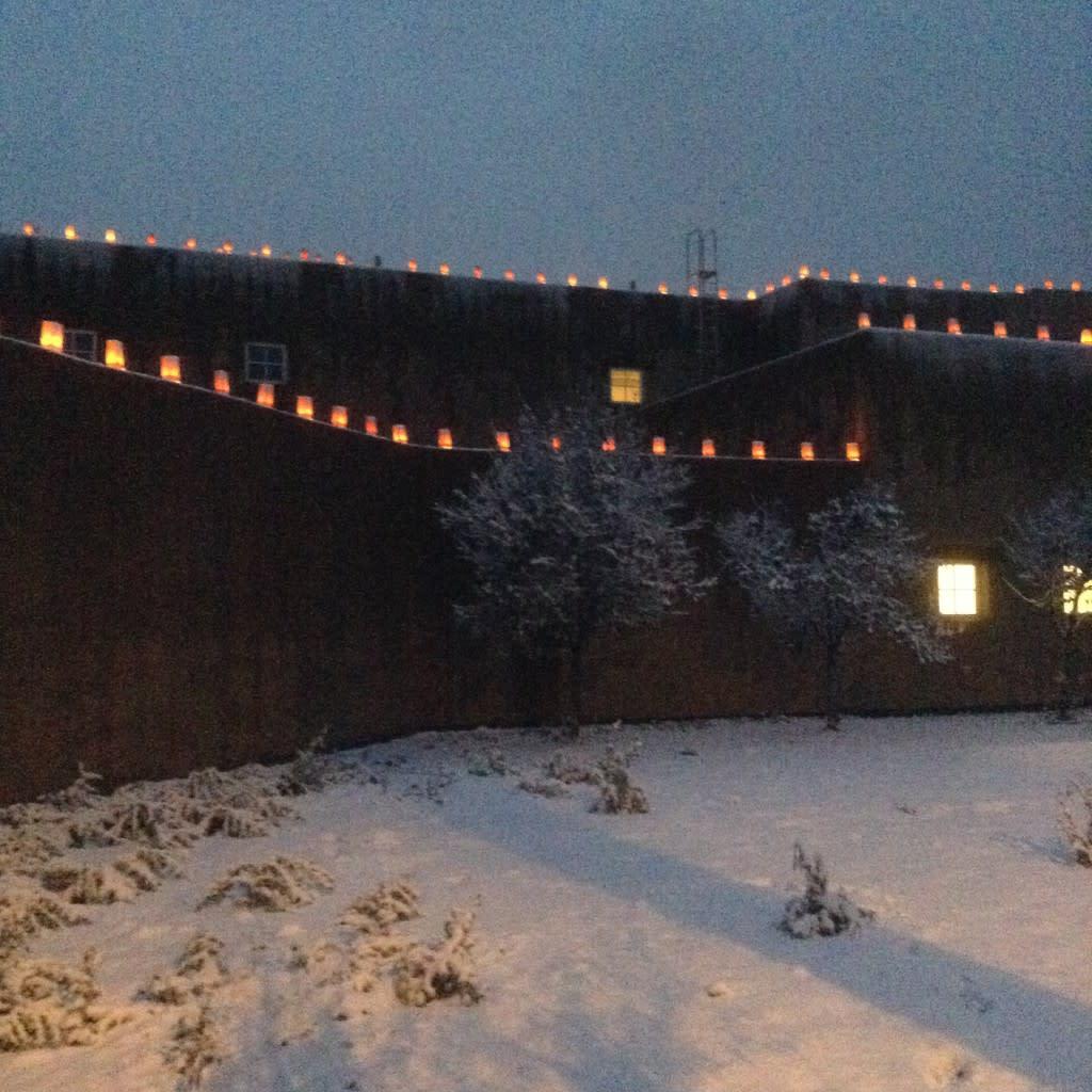 Snowy evenings + farolitos = Pure Santa Fe Joy Photo courtesy of John Feins