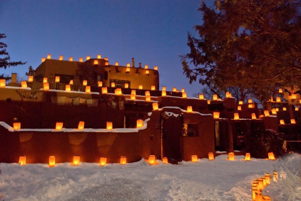 Farolitos adorn adobe walls on the eastside of Santa Fe. Photo courtesy of Jack Parsons
