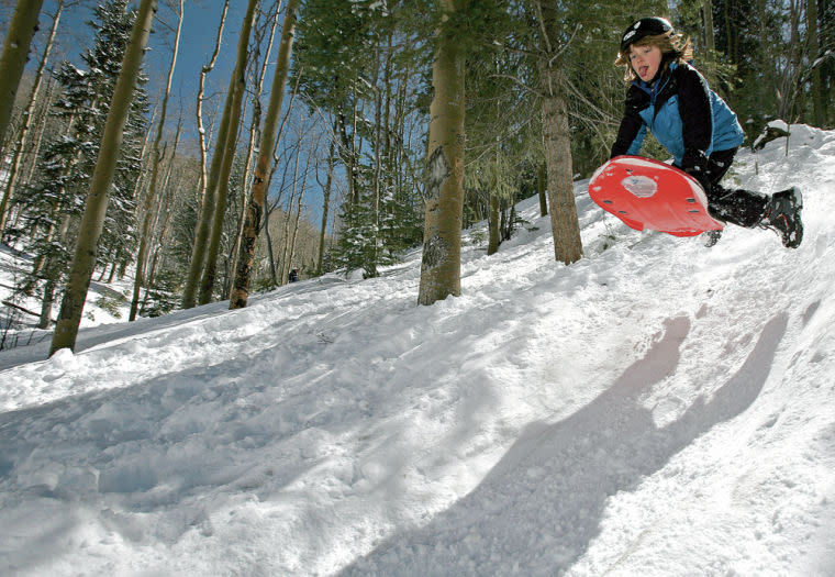 With the Sangre de Cristo Mountains in our backyard, Santa Fe is the perfect base for sledding adventures. (Photo courtesy of The Santa Fe New Mexican)