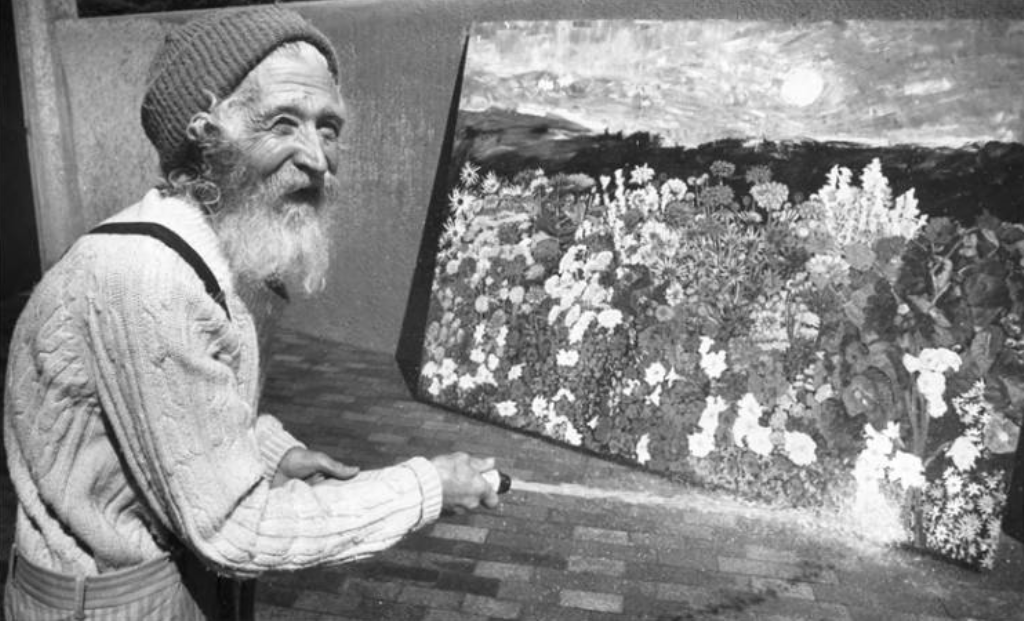 Tommy Macaione and one of his paintings. (Photo courtesy of Palace of the Governors Photo Archives Negative HP.2014.14.879)