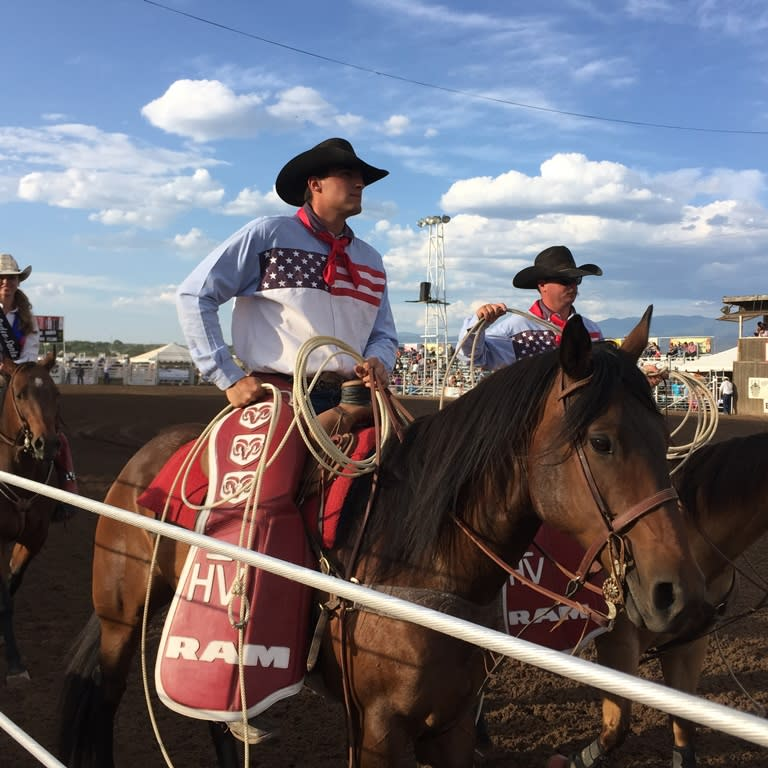 Rodeo participants line up in the arena before the rodeo. (Photo courtesy of TOURISM Santa Fe)