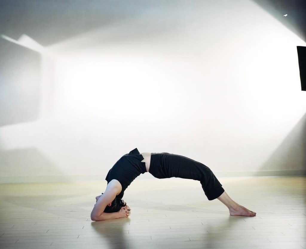 Want to strengthen your back muscles? A Chakrasana yoga pose will help you. (Photo courtesy of Body of Santa Fe)