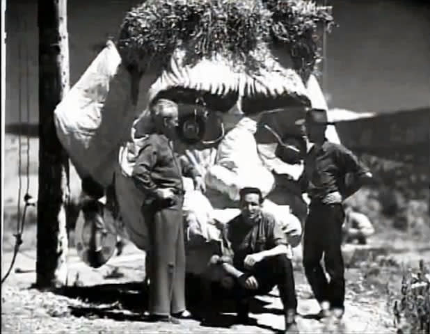 Creator Will Schuster in front of the Zozobra head. (Photo courtesy of New Mexico Museum Art Library and Archives, 1949)