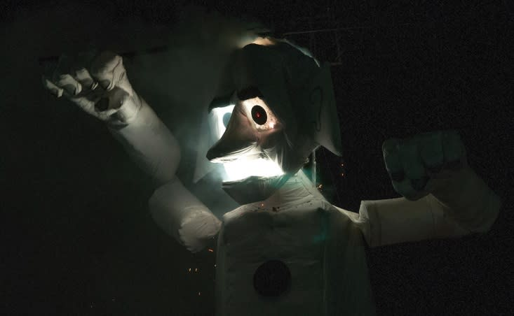 A 1930's looking Zozobra catches fire in last year's burning at Fort Marcy Park. (Photo courtesy of Eddie Moore, The Albuquerque Journal)