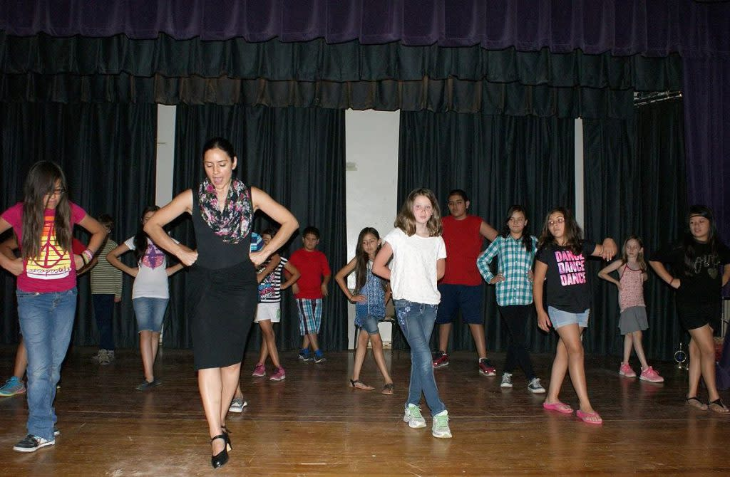 Kids can learn the Spanish dance and percussion of Flamenco at Entreflamenco. (Photo courtesy of Entreflamenco)