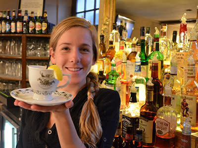 Reynolds-Tavern-girl-in-front-of-bar