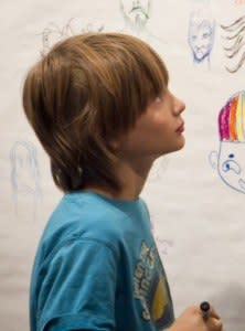 boy and drawings