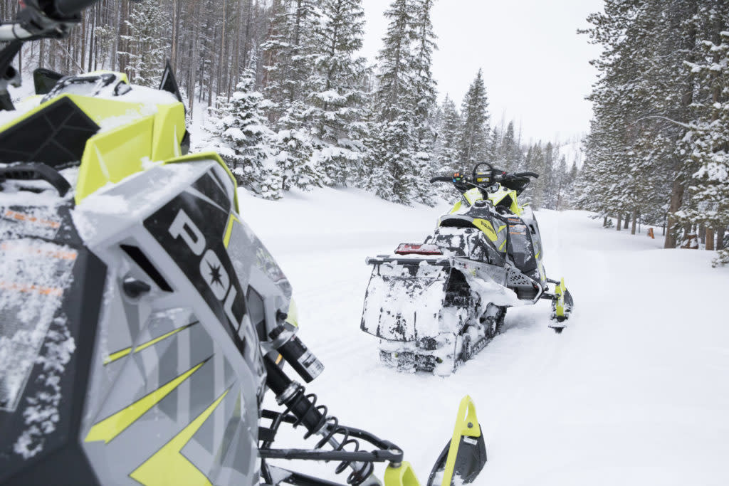 Albany Lodge guide snowmobiles