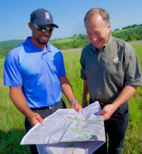 Tiger Woods and Johnny Morris look over plans for the new golf course.