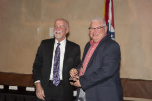 Don Patty (right) accepts the Ambassador Award on behalf of Premier Baseball.