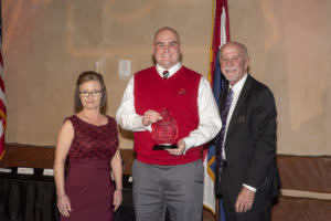 Dan Reiter (center) accepted the Hospitality Award on behalf of the Springfield Cardinals.