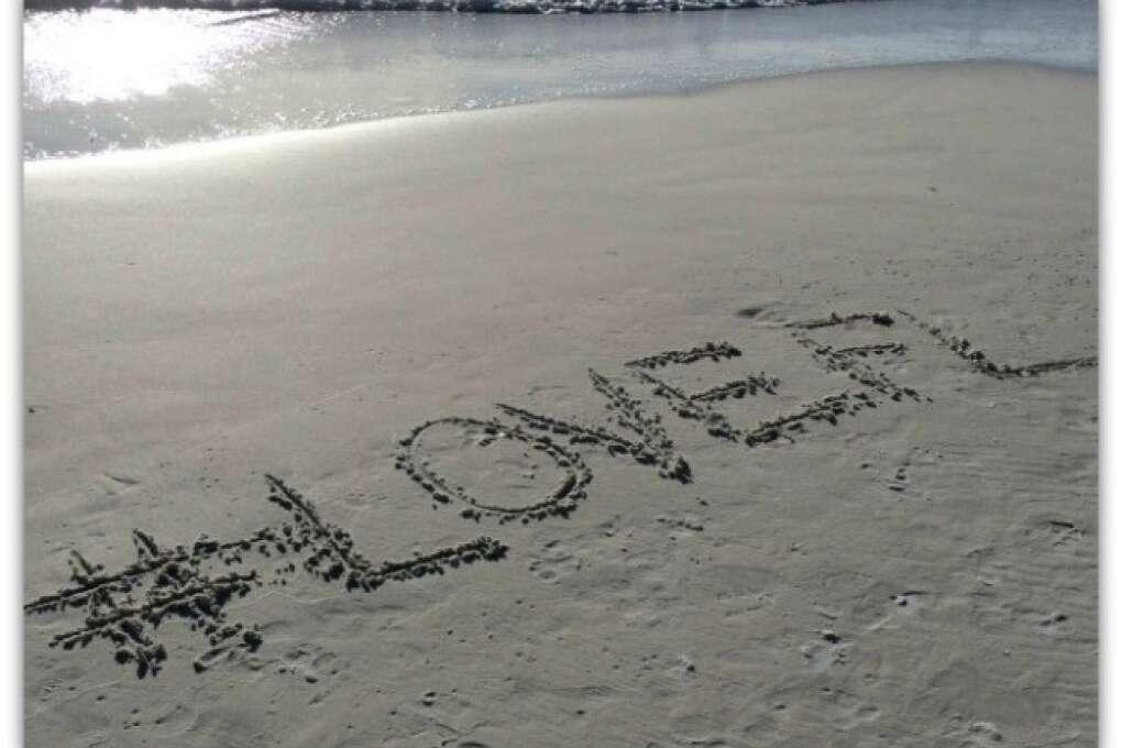 #LOVEFL written on the Anna Maria Island shore sands