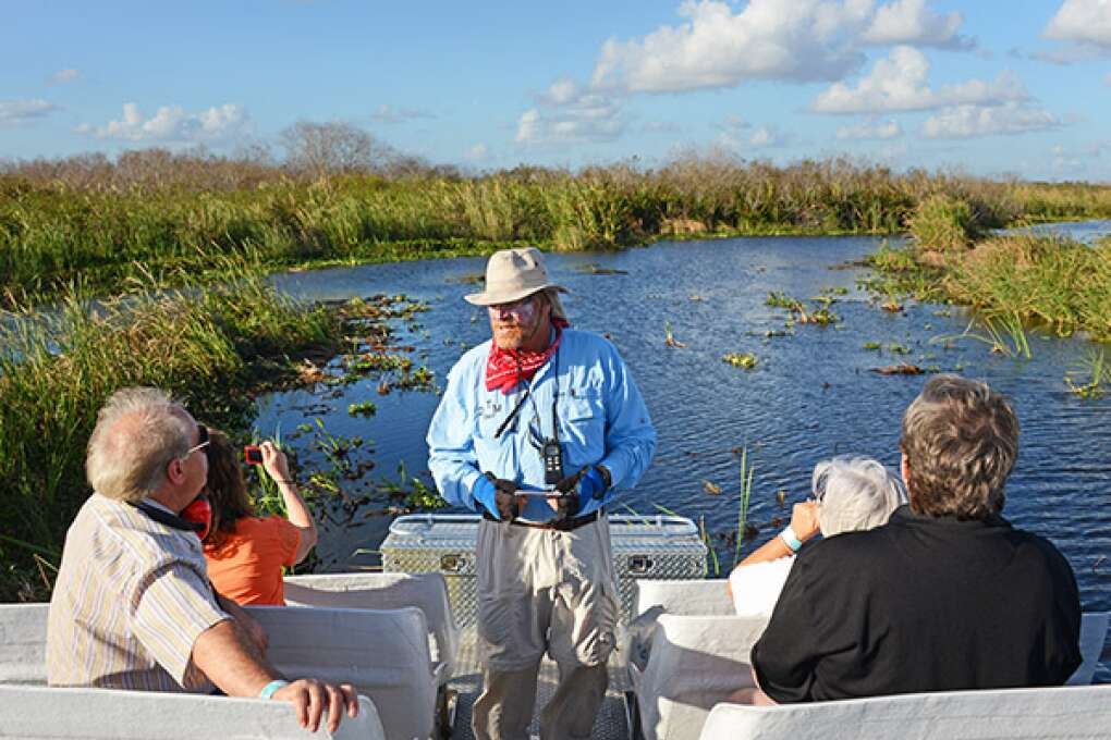 Loxahatchee Everglades Tours guide 'Dan The Man' Bauer skims people over the Everglades to see animals and dense tropical hammocks, and experience a deep silence.