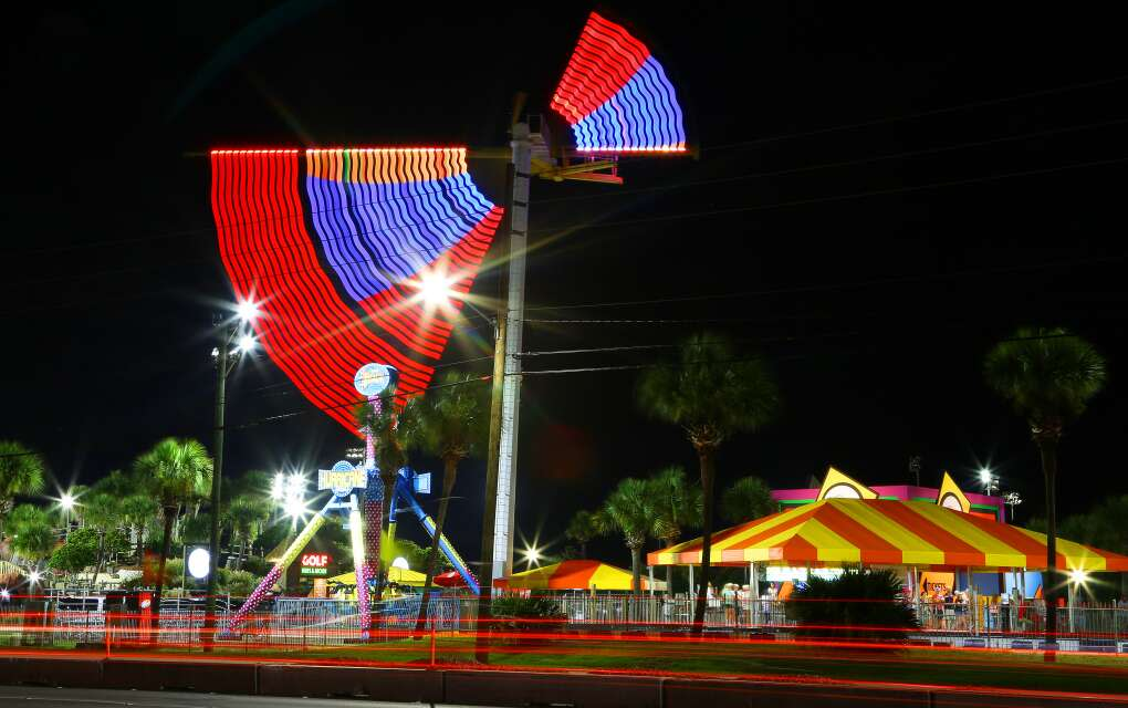 An amusement ride lights up the night at The Track, Destin. Bungee jumping and go carts are just some of the activities for families.