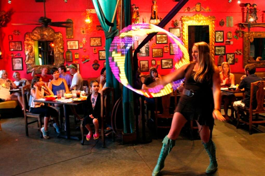 Hooper Abby Albaum has been entertaining with her glow in the dark hula hoop every Friday for six years at Casa Tina's Mexican Restaurant, which has entertainment every Friday, Saturday and Sunday at 8 and 9 p.m..