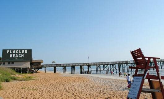 Enjoy eclectic shops, surfing, a classic fishing pier and free access to the beach at Flagler Beach.