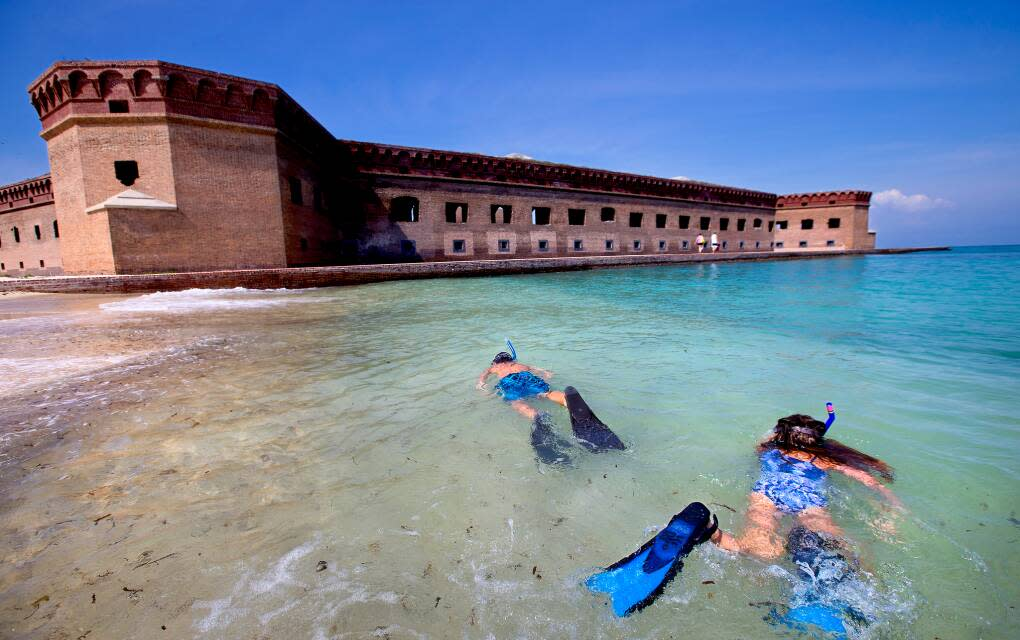 Children snorkel in the beautiful waters surrounding Fort Jefferson in the Dry Tortugas