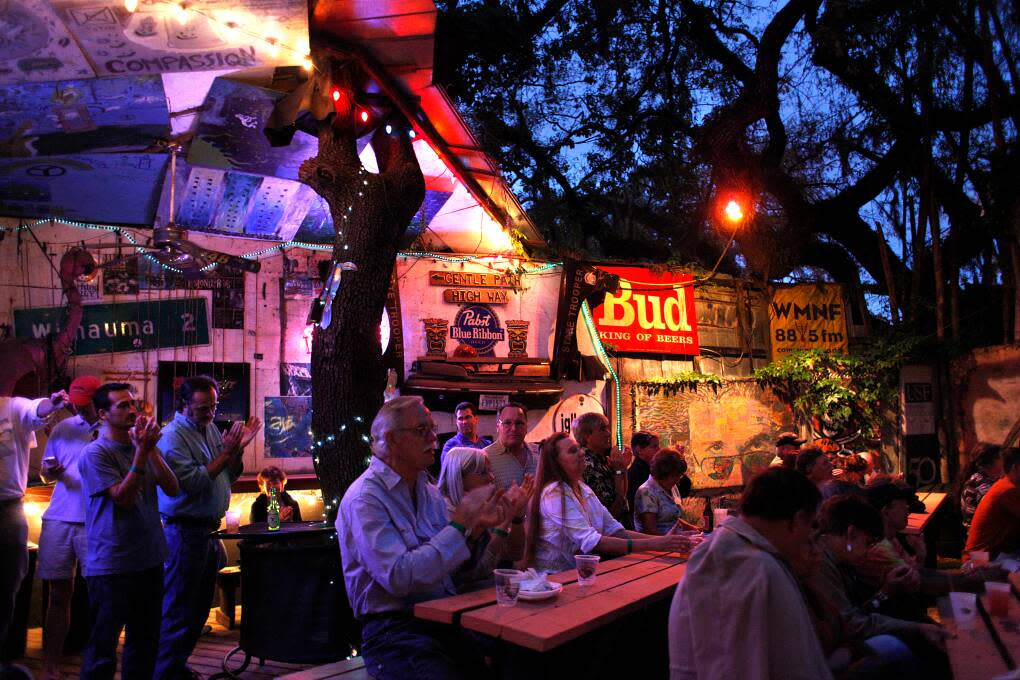"""Around Skipper's, visitors will find hand-painted murals, concert posters, framed pictures and florescent-lit beer signs. """"It looks like flotsam and jetsam,"""" the owner says."""