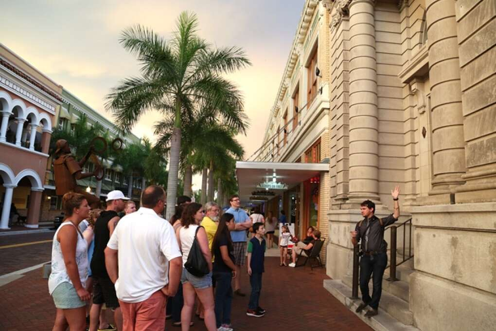 Visitors take in the historic buildings in Fort Myers River District.
